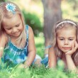 Two little sisters having fun in summer park — Stock Photo
