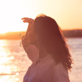 Enjoyment - free happy woman enjoying sunset — Stock Photo
