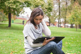 Young woman using tablet computer — Stock Photo