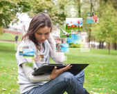 Woman sharing photo social media using tablet computer — Stock Photo