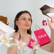 Woman shopping online using her virtual interface — Stock Photo