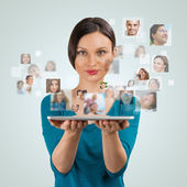 Young woman   with many different people's faces — Stock Photo