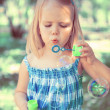 Little girl with soap bubbles — Stock Photo #45371161