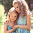 Outdoor portrait of two embracing cute little girls — Stock Photo #45371505
