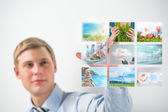 Man selecting tv channel virtual touch screen — Stock Photo