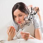 Woman listening music smartphone  — Stock Photo