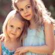 Two embracing little girls — Stock Photo