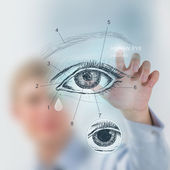 Doctor working with virtual interface eye — Stock Photo
