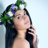 Woman with wreath of flowers — Stock Photo