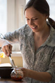 Woman cooking pizza  — Stock Photo