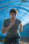 Athlete  running in city — Stock Photo