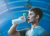 Athletic  man drinking water — Stock Photo