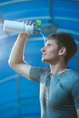 Athlete splashing  water on head — Stock Photo