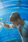 Man  splashing water over face — Stockfoto