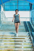 Sports woman walking stairs — Foto Stock