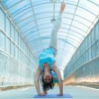 Woman doing yoga stretching bridge pose — Stok fotoğraf #49524547