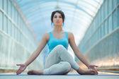 Woman doing meditating yoga exercises — Stock Photo