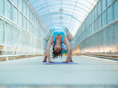 Woman doing yoga stretching bridge pose — Stock Photo