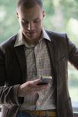 Businessman reading text message — Stock Photo