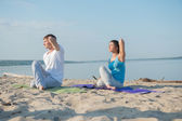 Young couple practicing yoga — Stock Photo