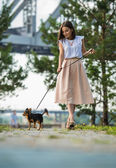 Girl strolling with her dog — Stock Photo