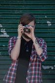 Man making photo on retro film camera — Stock Photo