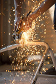 Plumber using an angle grinder machine — Stock Photo