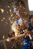 Plumber using grinder machine — Stock Photo