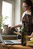 Woman In Kitchen Cuddling her Cat — Stock Photo