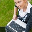 Beautiful young woman using laptop at outdoor — Stock Photo #6082687