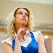 A portrait of a young business woman in a hall of an office buil — Stock Photo #6654900