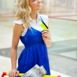 Photo of young joyful woman with shopping bags inside mall — Stock Photo #6654905