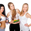 Three beautiful young women wearing sportswear isolated against — Stock Photo #6871944