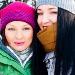 Two happy friends having fun in winter — Stock Photo #8660312