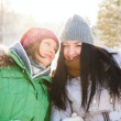 Two winter women walking and chatting together in winter park. — Stock Photo #8660326