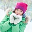 Winter woman in snow looking at camera outside on snowing cold — Stock Photo #8660693