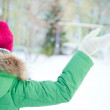 Portrait of a winter woman playing with snow. Photo from behind — Stock Photo #8660718