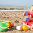 Baby playing on the beach — Stock Photo #12763921