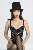 Asian girl in top hat — Stock Photo