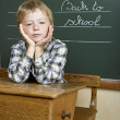 Portrait of lovely boy at school looking at camera — Stock Photo