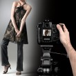 Professional photographer at studio fashion shot with a model. — Stock Photo #12767839
