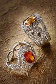Diamond rings with gems — Stock Photo