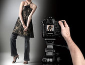 Professional photographer at studio fashion shot with a model. — Stock Photo