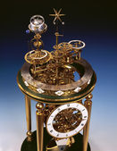 Antique clock with perpetual motion. — Стоковое фото