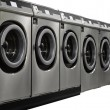 Row of industrial washing machines in public laundromat — Stock Photo #17424697