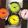 Foto de Stock  : Four colorful watches