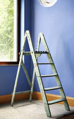 Home improvement with ladder and blue wall — Stock Photo
