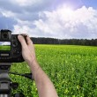 Man photographing landscape with digital camera — Stock Photo