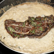 Stock Photo: Pork steak in pwith cream and tarragon