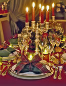 Christmas themed dinner table — Stock Photo